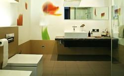 Czym przyklejać płytki w łazience
